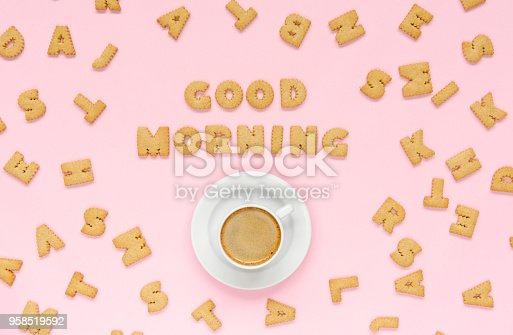 Cookies with cup of coffee on pink background