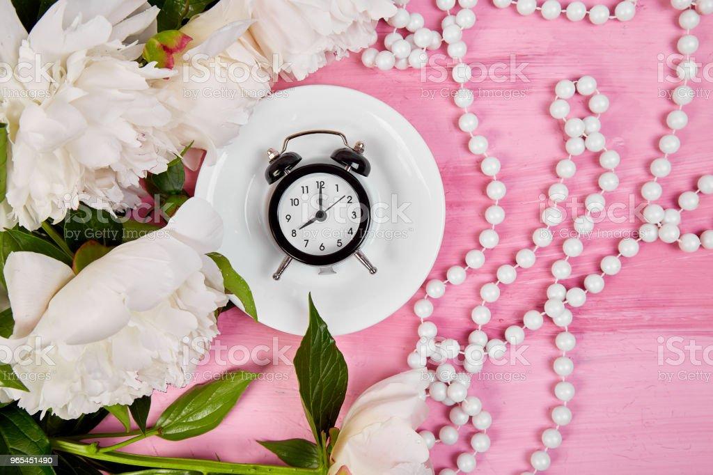 Good morning.  Tea, alarm clock and peony royalty-free stock photo