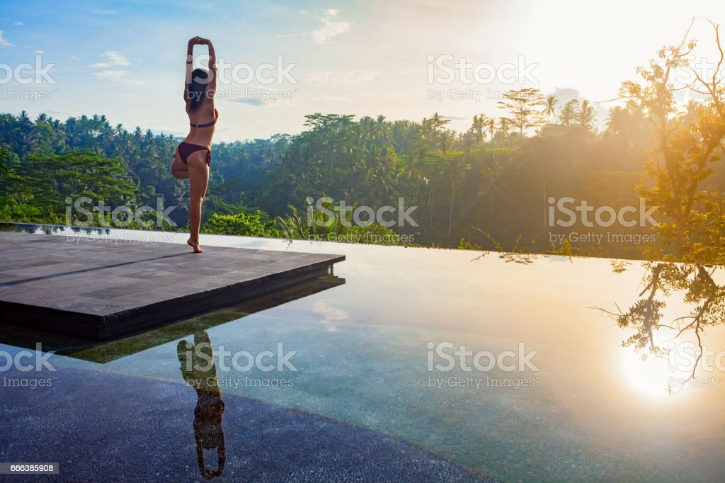 Good morning with woman yoga meditating on sunrise background. royalty-free stock photo