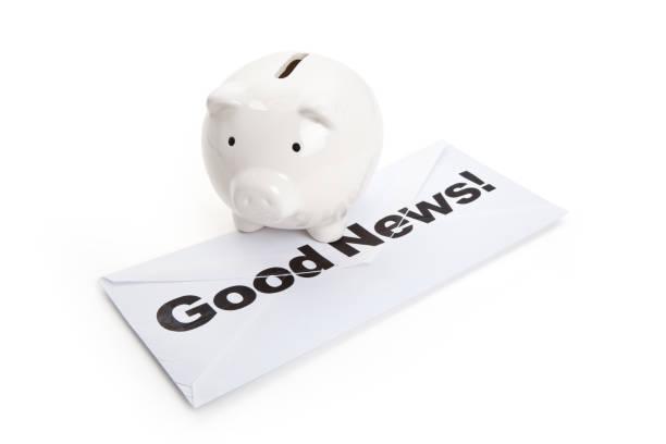 Good News and Piggy Bank stock photo