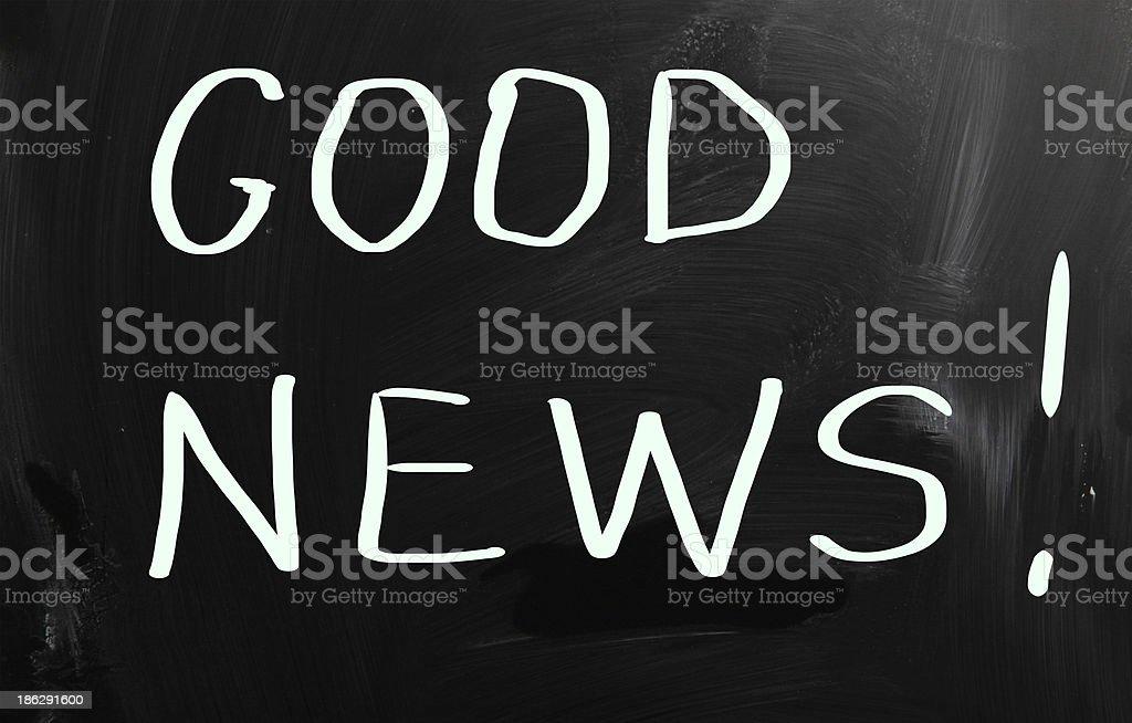 'Good News!' handwritten with white chalk on a blackboard royalty-free stock photo