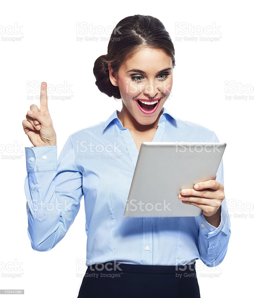 Good news Portrait of excited businesswoman holding a digital tablet. Studio shot on a white background. 20-24 Years Stock Photo