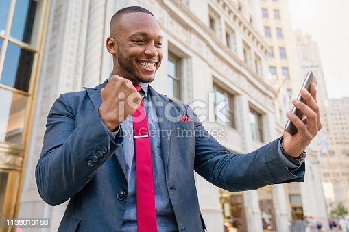 istock Good News Successful Businessman Chicago 1138010188