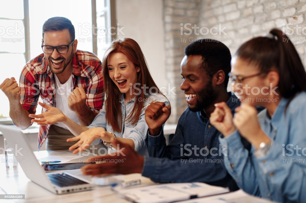 Good news young team in the office stock photo