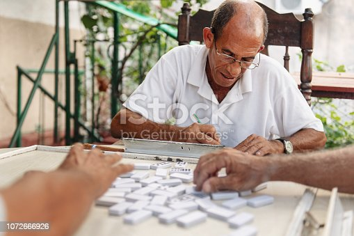 Good old latino friends playind domino