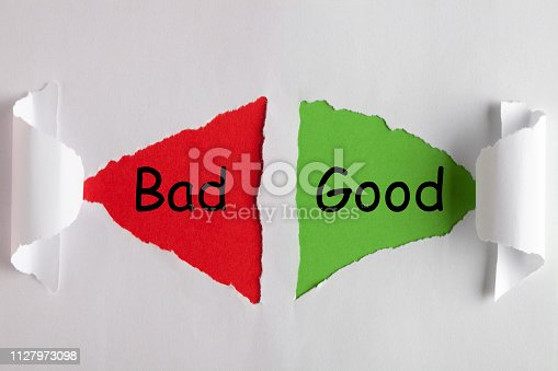 Good or Bad words on white torn paper with triangle shape. Business concept