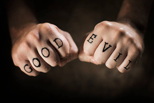 good or evil - knuckle stock photos and pictures