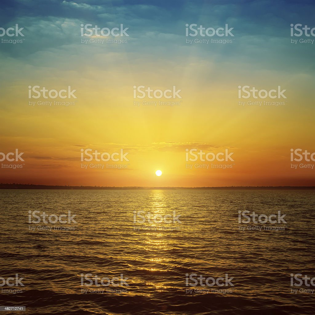 good orange sunset over sea stock photo