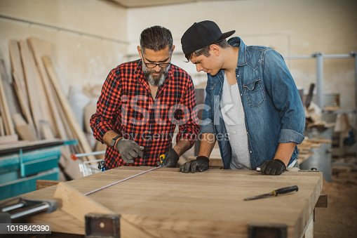 1000309654 istock photo Good organized father and son 1019842390