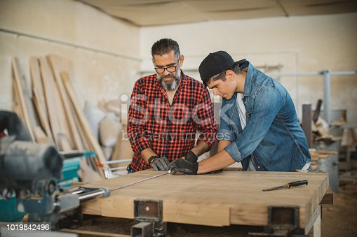 1000309654istockphoto Good organized father and son 1019842496