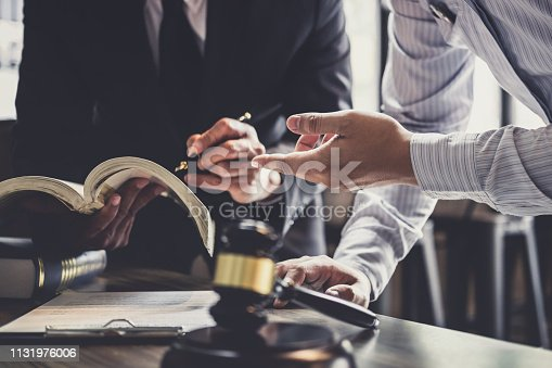 istock Good service cooperation, Consultation of Businessman and Male lawyer or judge counselor having team meeting with client, Law and Legal services concept 1131976006