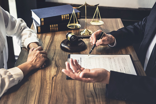 Good service cooperation, Consultation of Businesswoman and Male lawyer or judge counselor having team meeting with client, Law and Legal services concept.