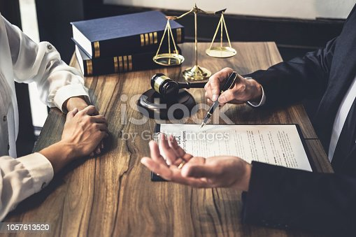 istock Good service cooperation, Consultation of Businesswoman and Male lawyer or judge counselor having team meeting with client, Law and Legal services concept 1057613520