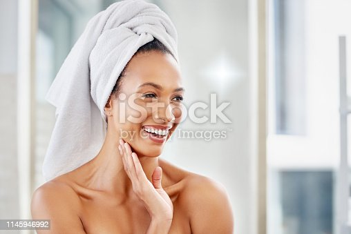 Shot of an attractive young woman going through her morning beauty routine at home