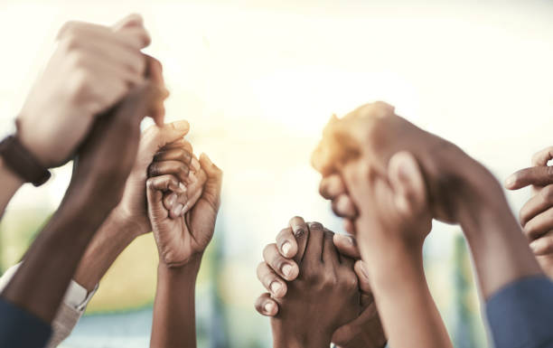 Good teams become great ones when they support each other Cropped shot of a group of businesspeople holding their hands in solidarity unity stock pictures, royalty-free photos & images