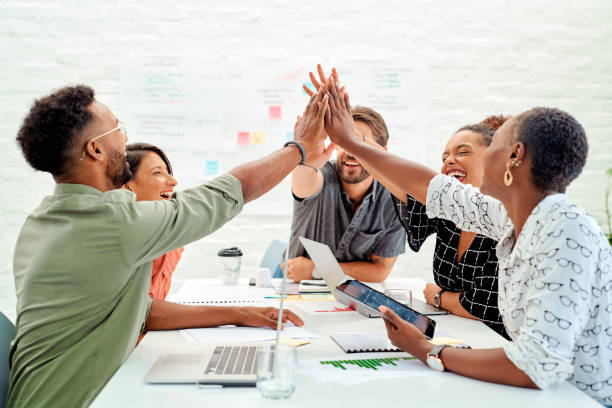 Good teamwork means a synergistic way of working towards a shared goal stock photo