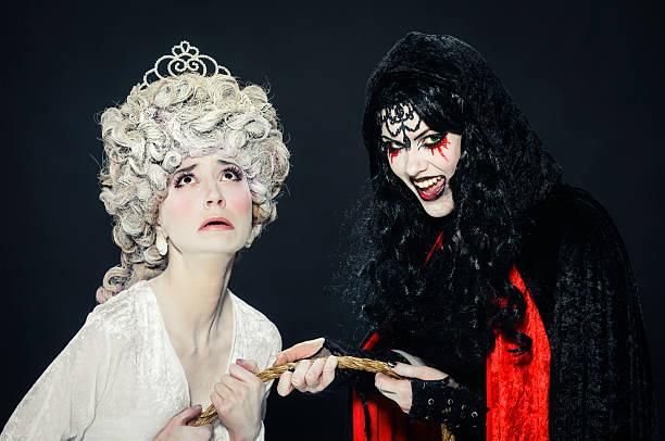 good vs. evil - bestes halloween make up stock-fotos und bilder