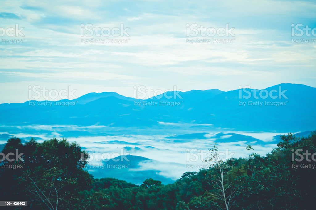 good view of mountain range and sea mist  at  early morning time relax outdoor nature wallpaper background stock photo