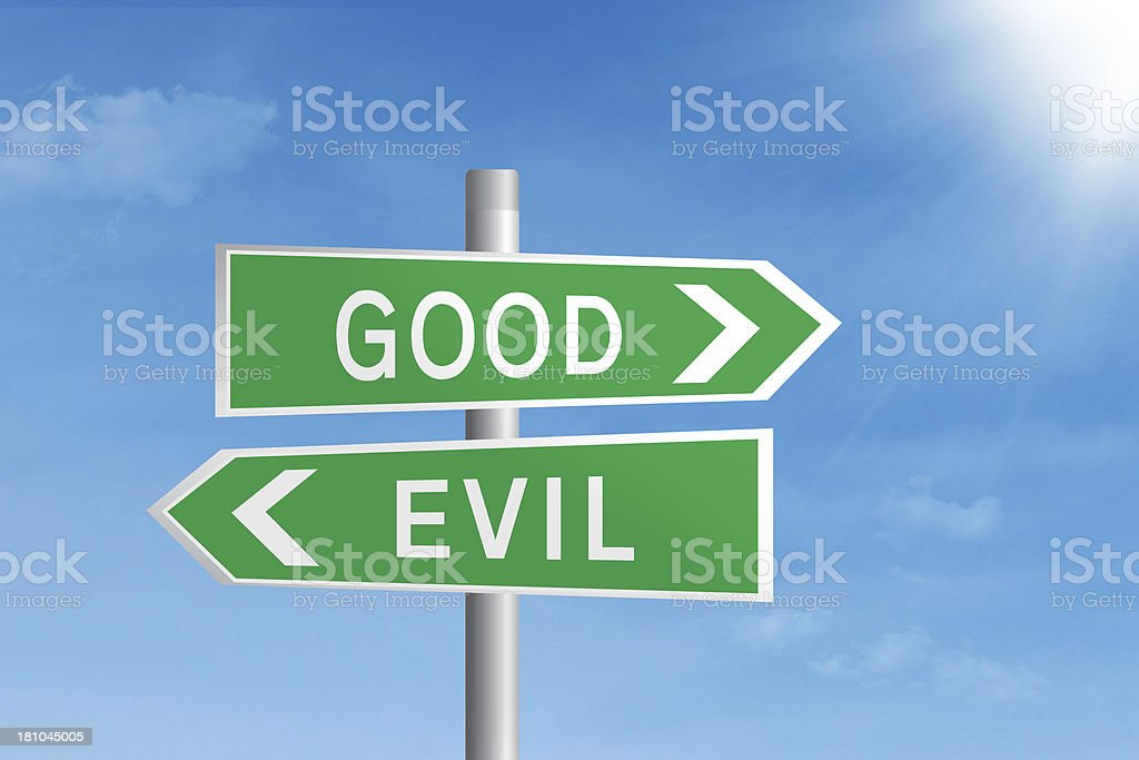 Good vs evil road sign stock photo