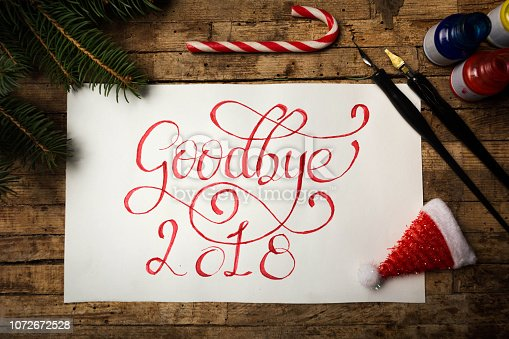 Goodbye 2018 written in red ink with calligraphic letters