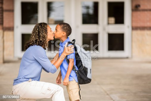 istock Goodbye. Little boy kisses mom on first day of school. 507329655