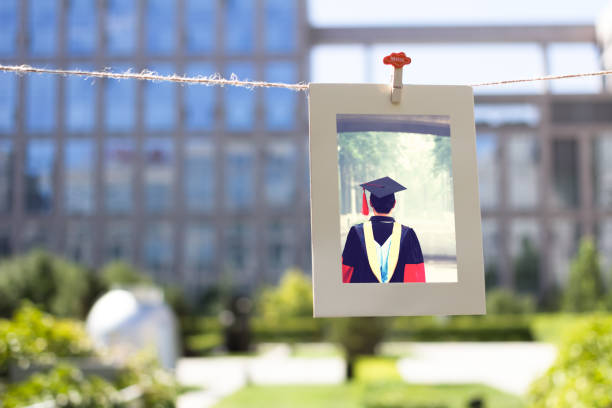 Goodbye My University Picture frame hanging on a string, surrounded by buildings and plants. alumnus stock pictures, royalty-free photos & images