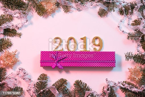 istock goodbye outgoing year jewelry gift box fir tree 1176676382