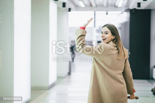 Businesswoman at the airport going away on the business trip