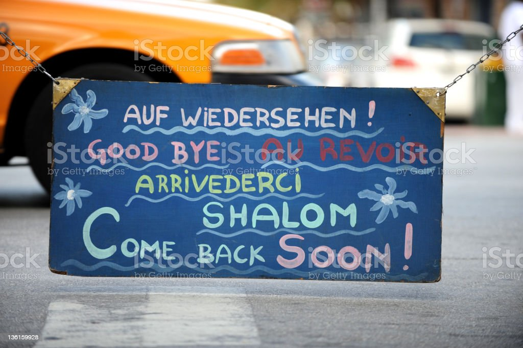 Goodbye Written in Several Languages on Sign stock photo
