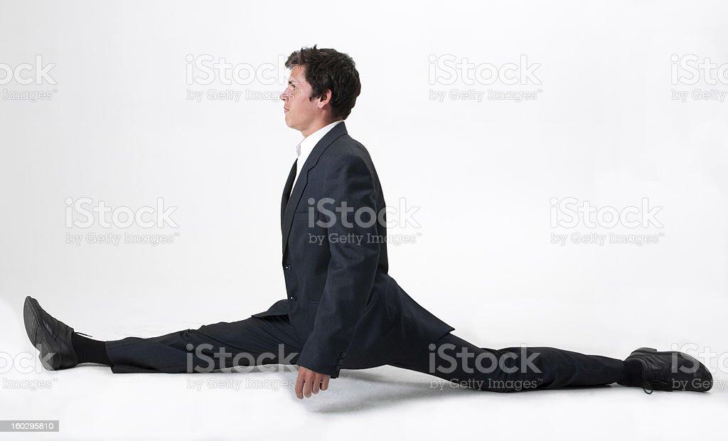 Good-looking businessman doing splits stock photo