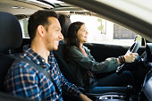 istock Good-looking dad and teenage girl driving together 1303145928