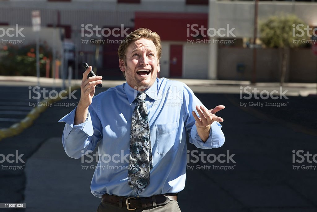 Good-looking guy frustrated with cell phone. royalty-free stock photo