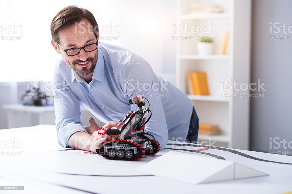 Good-looking intelligent researcher in the laboratory stock photo