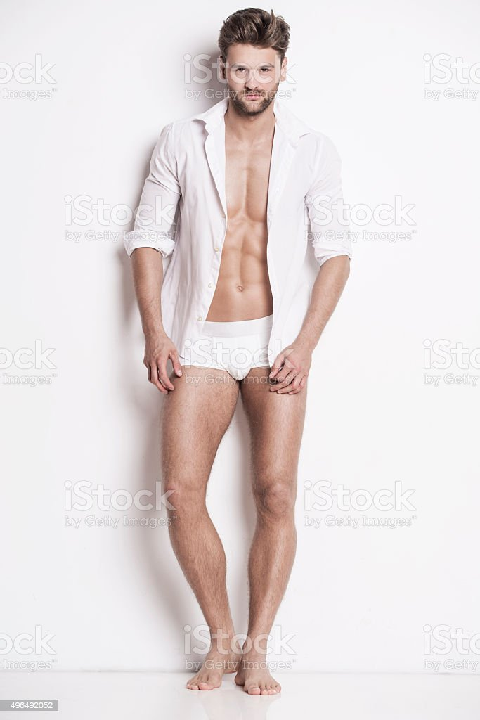 Good-looking man in white underwear stock photo