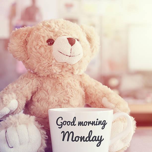 goodmorning monday coffee cup,in blurred background with vintage filter - glückliche montagszitate stock-fotos und bilder