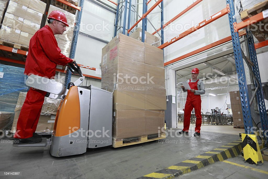 Goods delivery in storehouse royalty-free stock photo