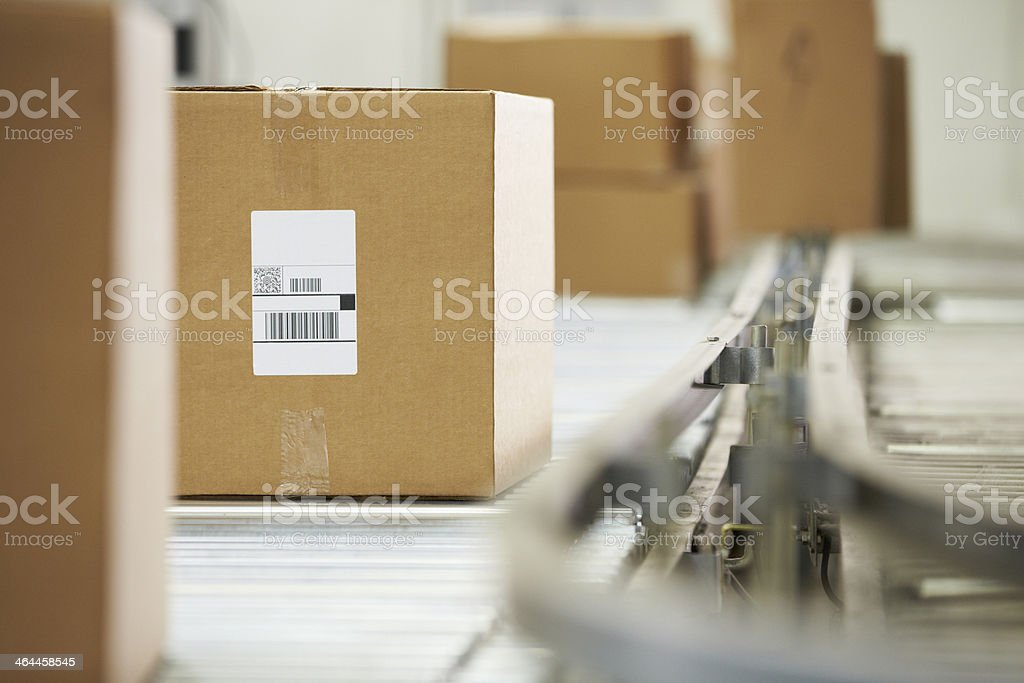 Goods On Conveyor Belt In Distribution Warehouse stock photo