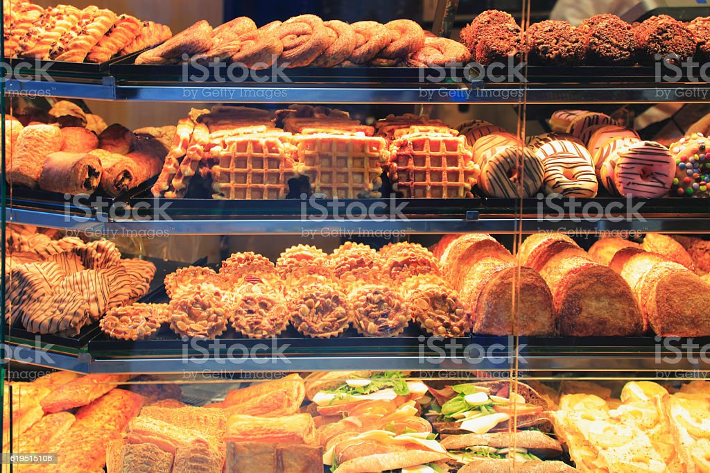 Goods stacked in a shop window of a bakery stock photo