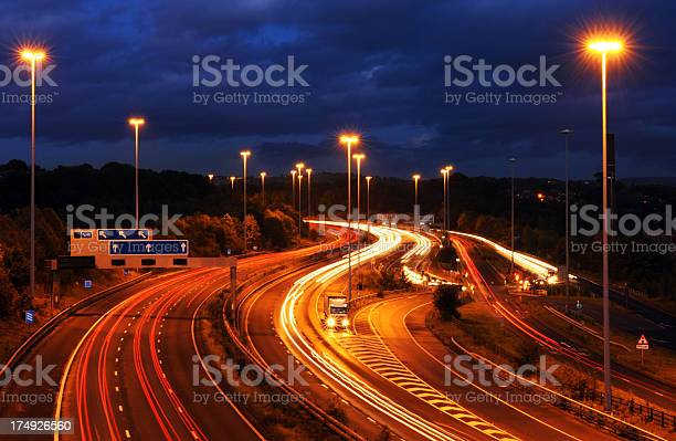 Photo of Goods Vehicle Breakdown at Dusk on Motorway with Light Trails