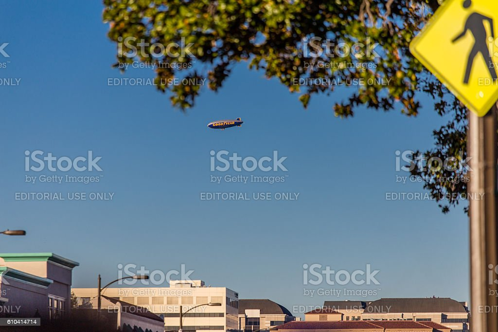 Goodyear blimp flying over the 2016 Rose Parade in Pasadena stock photo