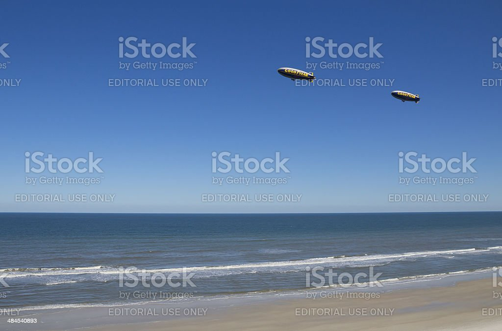 Goodyear Blimps along Atlantic Ocean stock photo