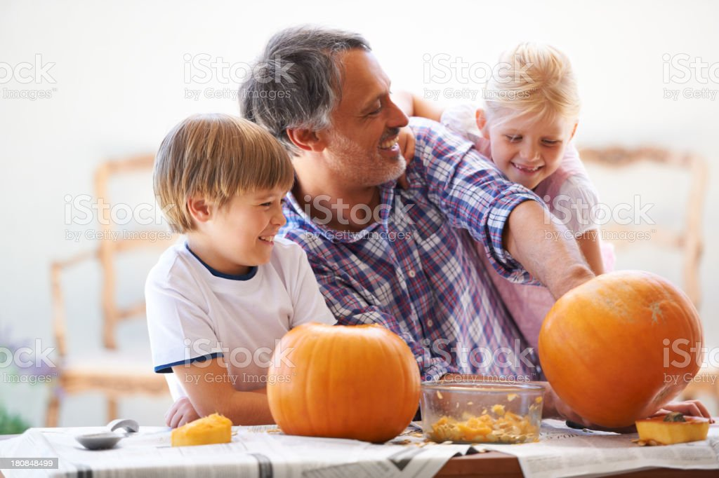 Goofing off while hollowing the pumpkins stock photo
