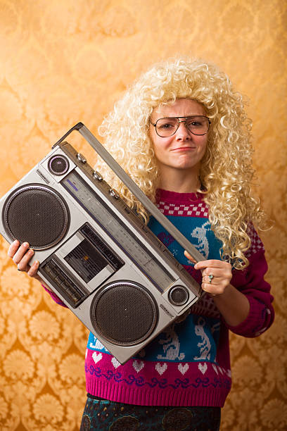 goofy 1980s teenager holding boombox - ugly girl stock photos and pictures