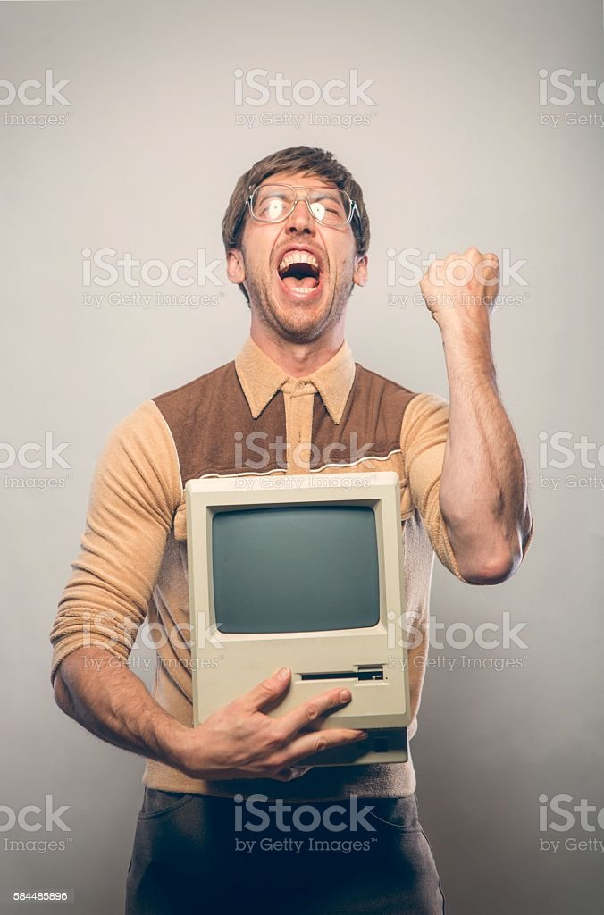 Goofy excited glasses nerdy IT Computer guy stock photo