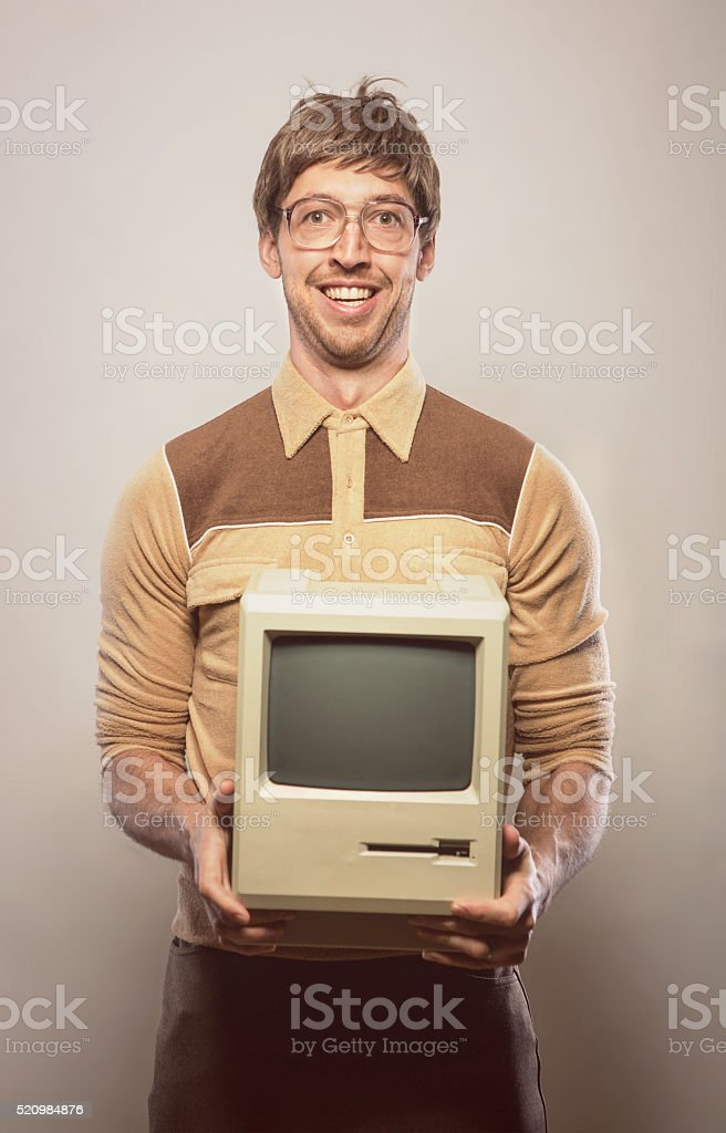 Goofy glasses wearing nerdy IT Computer guy stock photo