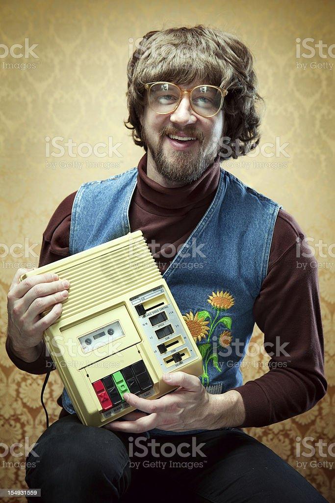 Goofy Hippy Professor with Cassette Tape Player stock photo