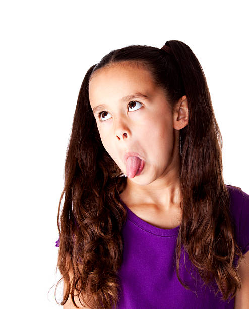Goofy Hispanic Girl Sticking Out Her Tongue Stock Photo - Download