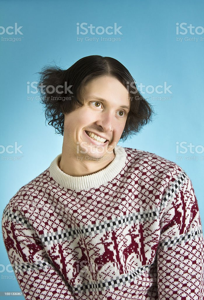 Goofy holiday sweater man stock photo