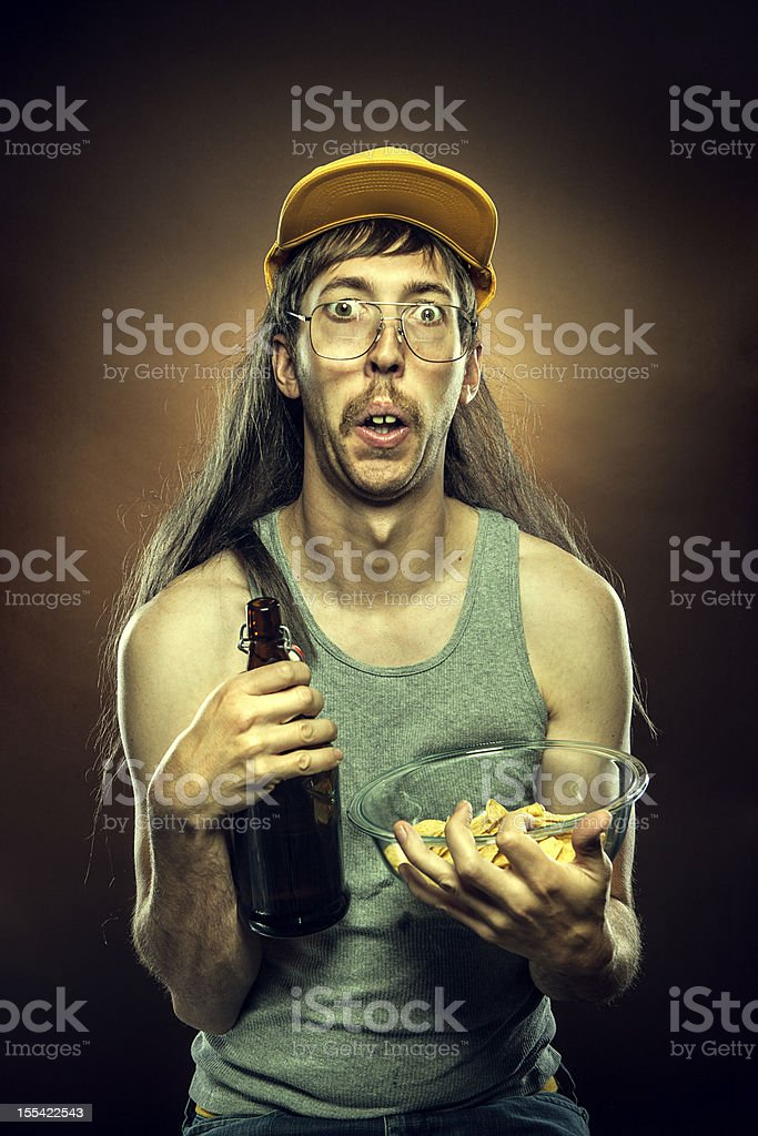 Goofy Redneck With Beer and Chips stock photo
