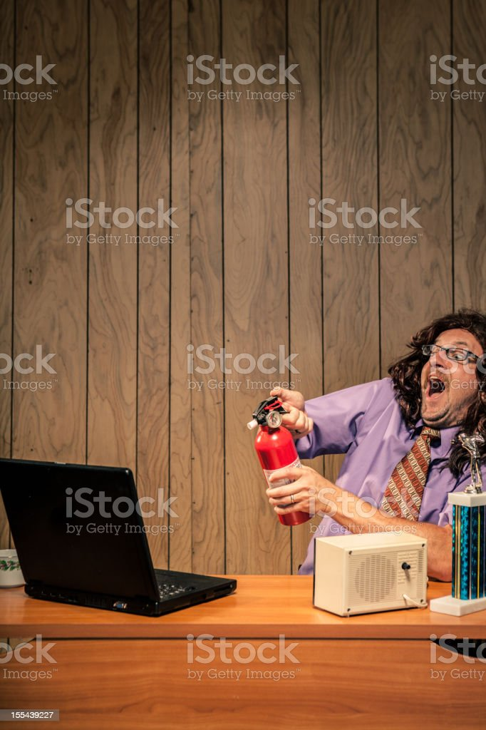 Goofy Silly Businessman Office Worker with computer fire extinguisher royalty-free stock photo